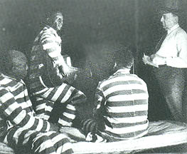 A staged shot of Leadbelly and fellow inmates.