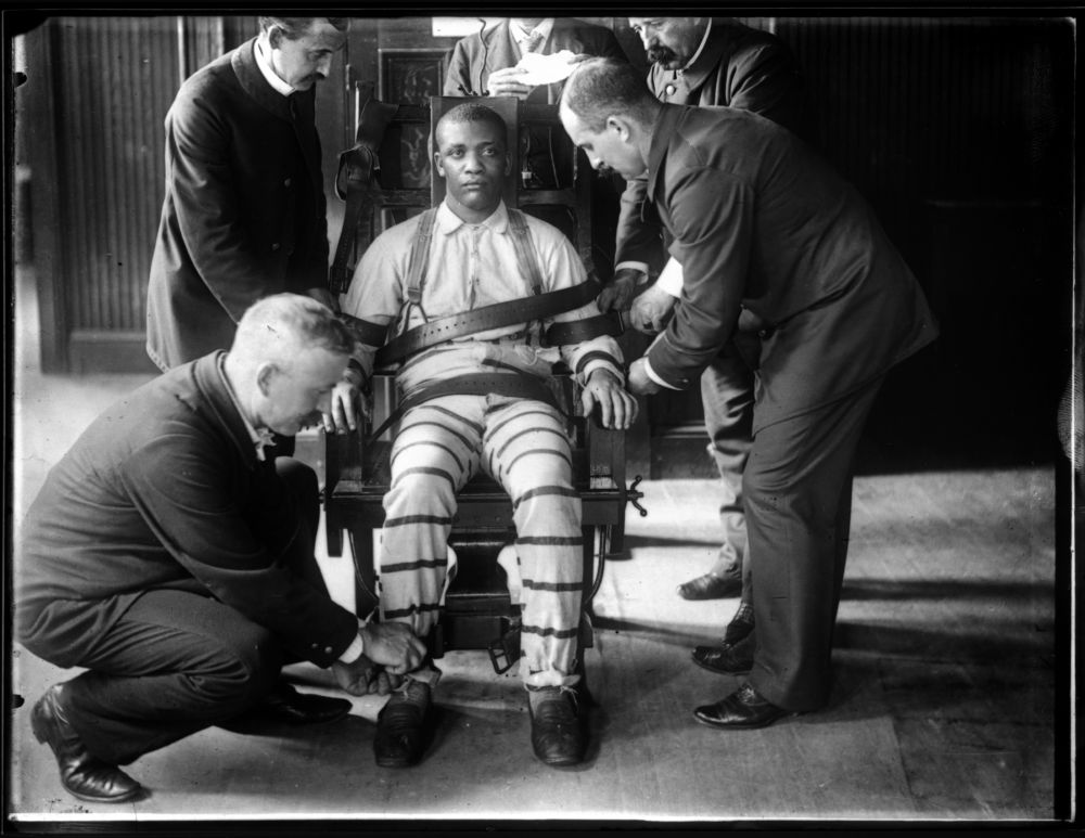 IDENTIFIED: 'An unidentified man is strapped into Sing Sing's electric chair.'